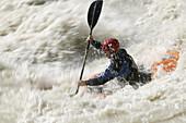 A man kayaking on the river Inn through the Imster Schlucht, Haiming, Tyrol, Austria