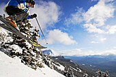 Lake Louise, Banff, a woman skis the powder snow of. Alberta, Rocky Mountains, Canada, North Amerika, MR