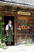 Mature woman looking out of doorway, Restaurant  Maurachalm, Nationalpark Hohe Tauern, Salzburger Land, Austria