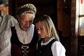 Mature woman and granddaughter (8-10), talking