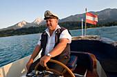 Skipper of a taxi boat service to the Inselhotel Faakersee, Lake Faak, Carinthia, Austria