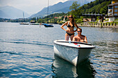 Couple having a boat trip, woman looking around, Millstätter See (deepest lake of Carinthia), Millstatt, Carinthia, Austria