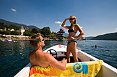 Couple on a boat trip, woman looking around, Millstaetter See, the deepest lake in Carinthia, Millstatt, Carinthia, Austria