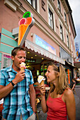 Young couple eating ice cream, Villach, Carinthia, Austria