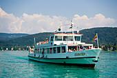 Excursion ship on the way to Maria Wörth, Lake Wörthersee (biggest lake of Carinthia), Maria Wörth, Carinthia, Austria