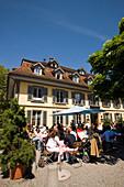 People sitting on terrace of a restaurant, Thun (largest garrison town of Switzerland), Bernese Oberland (highlands), Canton of Bern, Switzerland