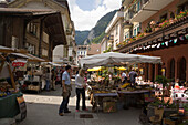 People strolling over flea market, Interlaken, Bernese Oberland (highlands), Canton of Bern, Switzerland