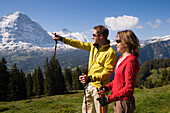 Couple enjoying the view over Bernese Alps, view to Eiger North Face 3970 m, Bussalp 1800 m, Grindelwald, Bernese Oberland, Canton of Bern, Switzerland