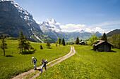 An older couple on the way to Grosse Scheidegg, Eiger 3970 m and Schreckhorn 4078 m in the background, Grindelwald, Bernese Oberland, Canton of Bern, Switzerland