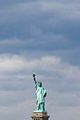 Statue of Liberty in front of cloudy sky, New York, USA