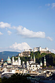 Panoramic view over Salzburg with Hohensalzburg Fortress, largest, fully-preserved fortress in central Europe, Salzburg Cathedral, Franciscan Church, St. Peter's Archabbey and Collegiate Church, built by Johann Bernhard Fischer von Erlach, Salzburg, Salzb