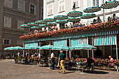 Guest sitting in the outdoor area of the Cafe Tomaselli, the oldest original Vienna Cafe of Austria, founded 1705, Old Market, Salzburg, Salzburg, Austria, Since 1996 historic centre of the city part of the UNESCO World Heritage Site