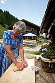 A woman making bread, Amoseralm 1198 m, Dorfgastein, Gastein Valley, Salzburg, Austria