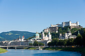 View over Salzach to Hohensalzburg Fortress, largest, fully-preserved fortress in central Europe, with Salzburg Cathedral and Collegiate Church, built by Johann Bernhard Fischer von Erlach, Salzburg, Salzburg, Austria, Since 1996 historic centre of the ci