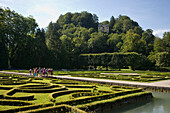 Group of children visiting water parterre, Month Palace in background, Hellbrunn Palace, oldest baroque palace site north of the Alps, Salzburg, Salzburg, Austria