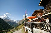 View along a mountain restaurant in Findeln to the Matterhorn (4478 m), Zermatt, Valais, Switzerland
