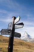 Signpost at hiking trail, Matterhorn (4478 metres) in background, Zermatt, Valais, Switzerland
