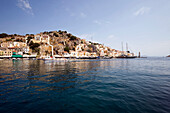 Picturesque view to neoclassicistic houses at mountainside, Simi, Symi Island, Greece