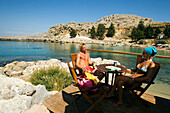 Couple in Beach Bar  Saint Paul's Bay (Agios Pavlos), Lindos, Rhodes, Greece