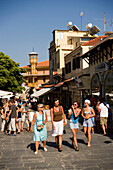 Women strolling over shopping street Odos Sokratous, Rhodes Town, Rhodes, Greece, (Since 1988 part of the UNESCO World Heritage Site)