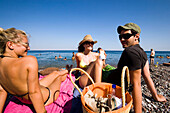 Group of young people sunbathing at Gennadi beach, Gennadi, Rhodes, Greece