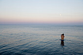 Young couple standing in water, embracing each other, Gennadi Beach, Rhodes, Greece