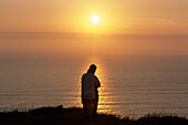Romantic Sunset Silhouette, Bedruthan Steps, near Newquay, Cornwall, England