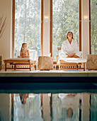 Mother and daughter meditating, Hotel Neuklostersee, Nakenstorf, Mecklenburg-Western Pomerania, Germany, MR, PR