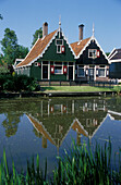 Historical houses at a canal at open air museum, Zaanse Schans, Netherlands, Europe