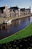 Houses along a canal, De Heerenwal, Sloten, Friesland, Netherlands, Europe