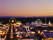 View over illuminated Oktoberfest in the evening, Munich, Bavaria, Germany