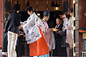 People in traditional clothes during a wedding, Asakusa Temple, Tokyo, Japan, Asia