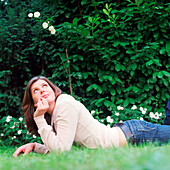 Mid adult woman lying on grass