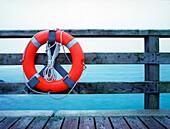 Life belt at balustrade of a pier, Dierhagen, Mecklenburg-Western Pomerania, Germany