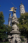 Statue in front of abbey church under blue sky, Neresheim, Baden-Wuerttemberg, Germany, Europe