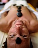 Man enjoying Hot Stone Massage, Germany