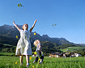 Girl and boy playing on mountain pasture, Leogang, Salzburg (state), Austria