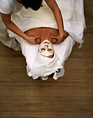Woman with face mask enjoying a neck massage, Wellness Hotel, Spa Area, Spa Hotel Seehotel Neuklostersee, Mecklenburg - Western Pomerania, Germany