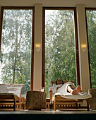 Woman relaxing, Hotel Neuklostersee, Nakenstorf, Mecklenburg-Western Pomerania, Germany