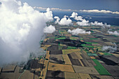 aerial photo of Fehmarn island, patchwork fileds, clouds, Baltic Sea, Schleswig Holstein, northern Germany