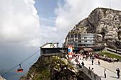People on platform of Hotel Bellevue, mount Esel (2118 m) in background, Pilatus (2132 m), Pilatus Kulm, Canton of Obwalden, Switzerland