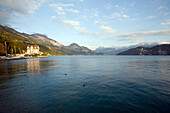 View over Lake Lucerne to Hotel Central am See and European Alps in background, Weggis, Canton of Lucerne, Switzerland