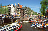 Amsterdam, Jourdan, party boats on canal at queens birthday