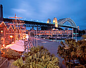 Restaurants in the evening, harbour bridge, Sydney, Australia