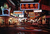 Neon lit roads with trams and traffic on Kowloon in Hong Kong