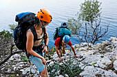 Two young people climbing, Il Sentiero Selvaggio Blu, Golfo di Orosei, Sardinia, Italy, MR