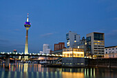 Modern architecture in the Media Harbour with television tower in the evening, Düsseldorf, state capital of NRW, North-Rhine-Westphalia, Germany