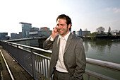 young buisness man in the district of media, new district of Düsseldorf, harbor, state capital of NRW, North-Rhine-Westphalia, Germany