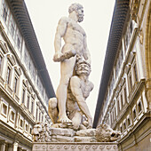 statue of Herkules with Cacus, Palazzo Vecchio, Florence, Tuscany, Italy, museum, sightseeing, landmark, tourism, tourists, travel, vacation, journey, culture, power, potency, souvereign, humility, art, holding a club in his hand, cudgel, townscape, man w