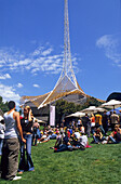 Young crowd watching free sunday concert in the Arts Center of Melbourne, Victoria, Australia
